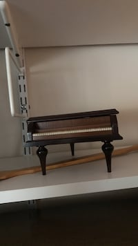 Brown and black upright baby grant piano with a Swiss movement Huntington, 11740