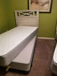 brown and white wooden bed frame Hattiesburg, 39401