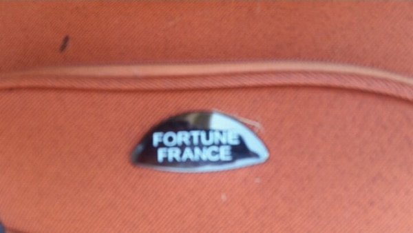 Fortune France small suitcase 089b810f-73a2-4b1c-96eb-503ab3b7583c