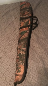 brown and black realtree camouflage rifle case