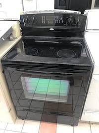 Black whirlpool gold 5 burners self cleaning oven electric stove in excellent working condition 100 days warranty  Baltimore, 21222