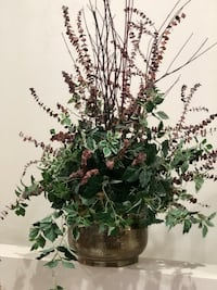 Floral arrangement is approximately 3' tall.  Includes Red Twig Doogwood branch's, eucalyptus and greens.  Comes from a non smoking home.  Nice metal container. Bellevue, 54311