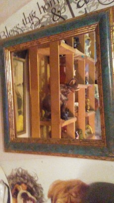 Pair of green and gold framed mirrors