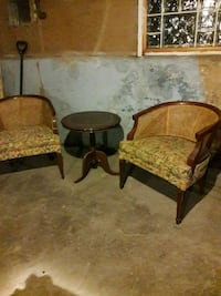 two brown cane back padded armchairs