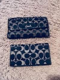 two black-and-grey Coach monogrammed clutch wallets