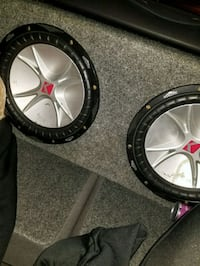 two black KICKER subwoofers with enclosure Hyattsville