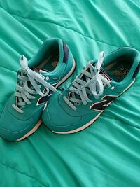 pair of teal Nike running shoes St. Louis, 63125