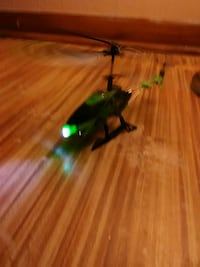 green and black R/C helicopter