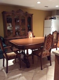Rectangular brown wooden dining table with chairs set with hutch  Toronto, M3H 4R4