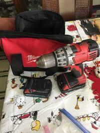 Milwaukee drill with two batteries and bag