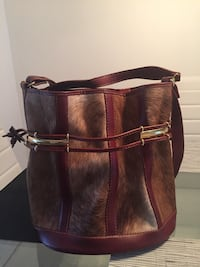 brown leather crossbody bag with tassel Montréal, H4E 1L2