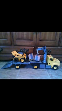 yellow and blue plastic hauler truck scale model