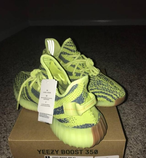 info for a165e 665fa pair of green Adidas Yeezy Boost 350 on box