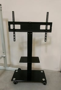 New in box 11x26x43 inches tall 32 to 65 inches tv television stand with wheels 90 lbs capacity  Whittier, 90605
