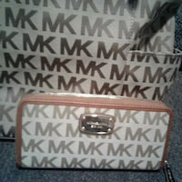 brown and white Michael Kors leather wristlet Londonderry, 03053