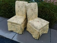 two yellow floral fabric chairs