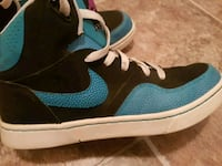 powder-blue-and-black Nike high-top sneakers 3155 km