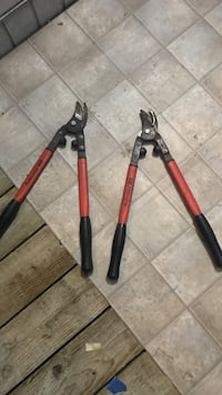 Two red and black lopping shears