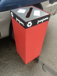 Red metal recycle bin