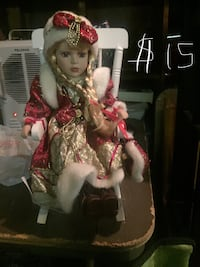 white, red, and grey dressed porcelain doll WASHINGTON
