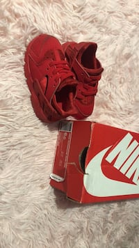 pair of red Nike basketball shoes New York, 10303