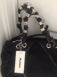 Black genuine leather & rabbit fur purse with the tags still on it Indianapolis, 46220