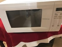 white General Electric microwave oven Coconut Creek, 33066
