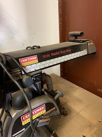 Sears 10 inch radial arm saw with several blades and wheeled table Chino, 91710