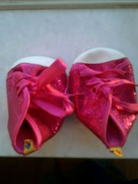 baby's pink-and-white glitter shoes unused