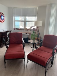 Two red indoor/outdoor chairs and ottomans  Miami, 33131