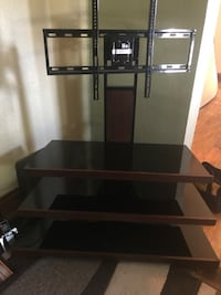 Brown cherry TV stand. Bought new from Best Buy for over $200. Held my 55inch flat screen.  Waterloo, 50703