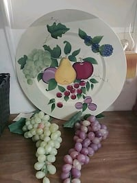 two grapes decor and round white and multicolored ceramic plate