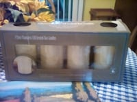 4 FLAMELESS CANDLES NEW W BATTERIES/TIMER 283 mi