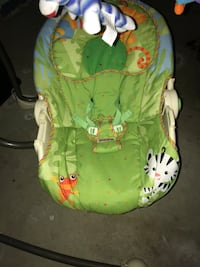 Baby's green and white bouncer 549 km