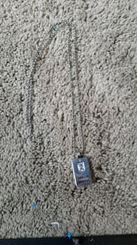 silver and black pendant necklace