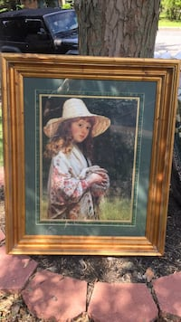 woman in pink dress painting with brown wooden frame Howell