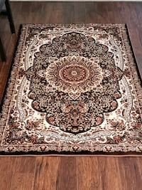 Brand new, main color is brown, 4'by6' area rug  Shoreview, 55126