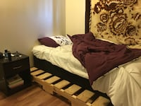 Brown wooden bed with brown comforter with the box.. new, used for only a week Thunder Bay, P7B 6A9