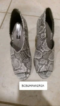 pair of gray snakeskin leather heeled shoes Jacksonville, 32218
