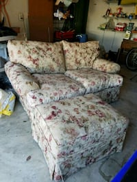 love seat with matching couch and ottoman.