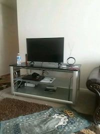 flat screen television with brown wooden TV stand Louisville, 40214