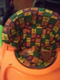 orange and multicolored highchair