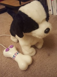black and white dog plush toy