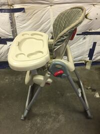 Adjustable high chair.  Anchorage, 99507