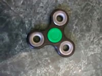 black, gray, and green hand spinner Goose Creek, 29445