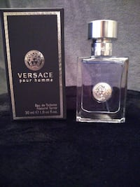 2 mens cologne and 1 woman's perfume