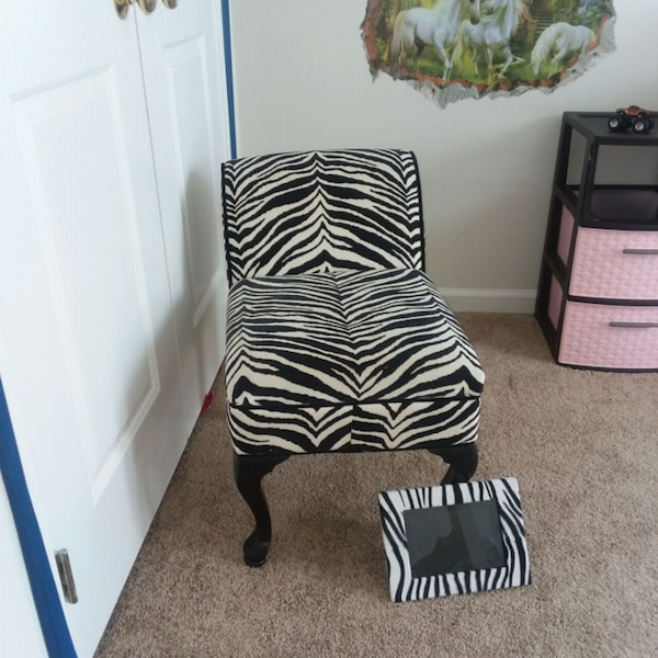 Zebra print stool with matching picture frame.