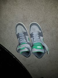 pair of gray-and-green Nike high-top sneakers