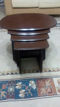 brown wooden 4 nesting table