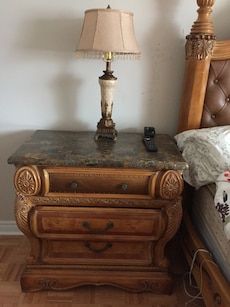 brown wooden granite top nightstand